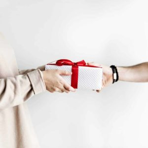 Couple receiving and giving a gift