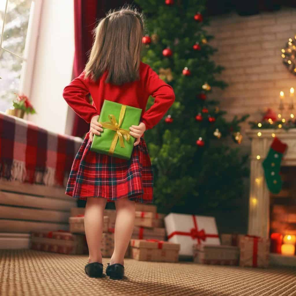 girl with Christmas gift.