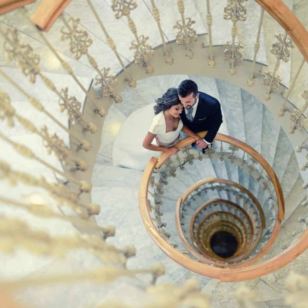 Just married couple in a spiral staircase