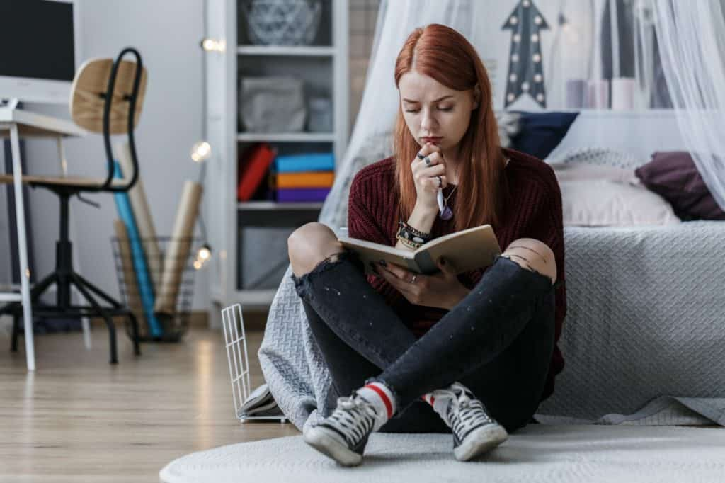 Girl thinking over notebook