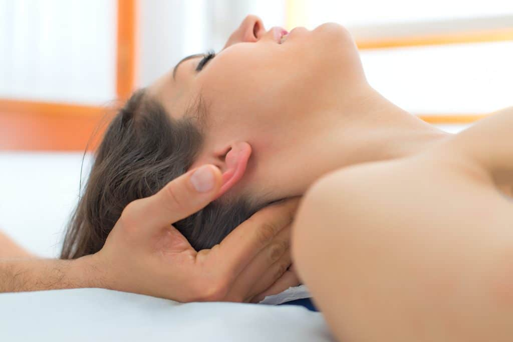 Therapist massaging the neck